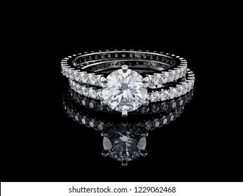 Wedding set of diamond engagement ring, wedding band on black glossy background. 3D illustration