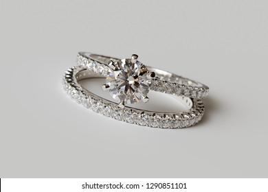 Wedding set, engagement ring, eternity band, scallop setting on white background. 3D  illustration