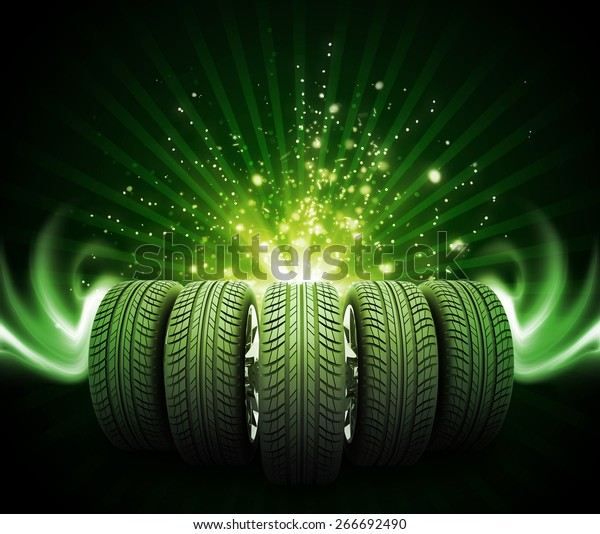 Wedge of new car wheels. Abstract green background is magic lines and stripes at center