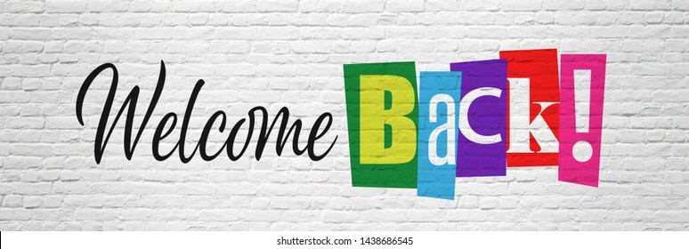 """""""Welcome back !"""" in cut letters on brick wall"""