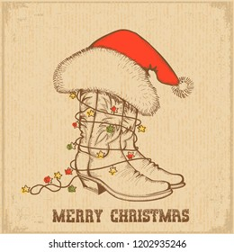 Western Christmas greeting card with cowboy traditional boots and Santa Claus hat on old paper background