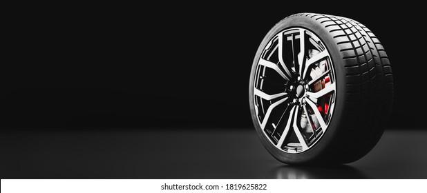Wheel with modern alu rims on black background. 3D illustration