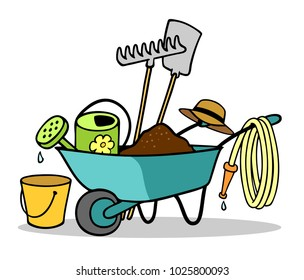 Wheelbarrow with tool for gardening in spring