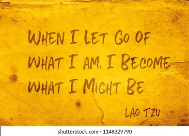 When I let go of what I am, I become what I might be - ancient Chinese philosopher Lao Tzu quote printed on grunge yellow paper