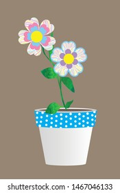 Whimsical blue and white polka dot flower pot with beautiful pastel patterned flowers in purple, pink, yellow, blue and green.