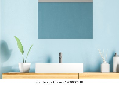 White angular bathroom sink standing on wooden countertop with rectangular mirror above it in blue wall room. 3d rendering