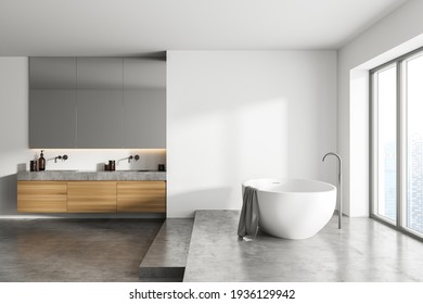 White bathroom interior with concrete floor and podium near window, side view. Minimalist light room with modern furniture, 3D rendering no people