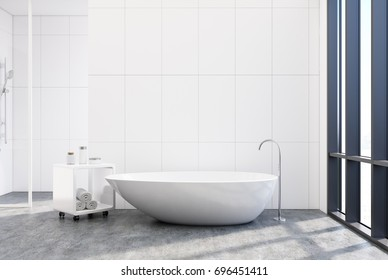 White bathroom interior with a concrete floor and an elegant white bathtub with a loft window. 3d rendering mock up