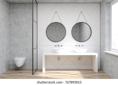 White bathroom interior with a wooden floor, a double sink with two round mirrors and a toilet. 3d rendering