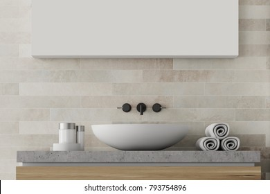 White bathroom sink near a white brick wall with a large mirror hanging above it. Front view. 3d rendering