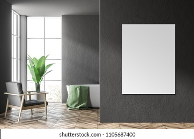 White bathtub with a green towel hanging on it standing in a modern bathroom interior with black walls and an armchair. A framed mock up poster to the right. 3d rendering