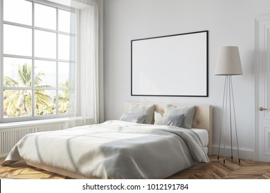 White bedroom corner with a white bed, a lamp and a framed horizontal poster hanging above the bed. 3d rendering mock up