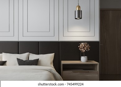 White bedroom interior with a double bed with a white bedclothes and gray and white pillows and a bedside table. 3d rendering mock up