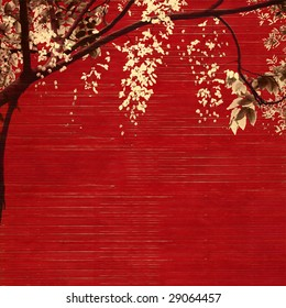 white and black blossom on red wooden slatted background