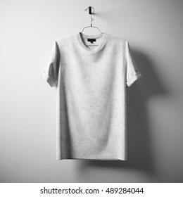 White Blank Cotton Tshirt Hanging Center Gray Concrete Empty Wall Background.Highly Detailed Texture Materials.Clear Label Space for Business Message. Square Mockup . 3D rendering