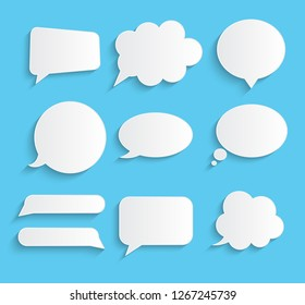 White blank retro speech bubbles set on blue background.  Illustration