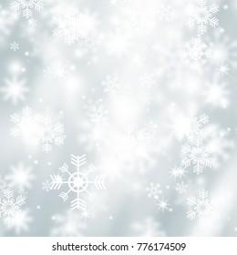 White blur abstract background. Bokeh Christmas blurred beautiful shiny Christmas lights. Snow background. Snowflakes overlay on winter background.
