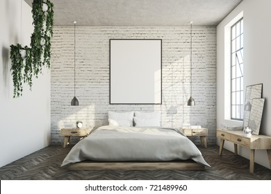 White brick bedroom interior with a wooden floor, a large window, a gray bed and two bedside tables. A cabinet with mirrors. 3d rendering mock up