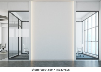 White brick open space office interior with a concrete floor, a blank wall fragment and a row of computer desks along the wall. Close up 3d rendering mock up