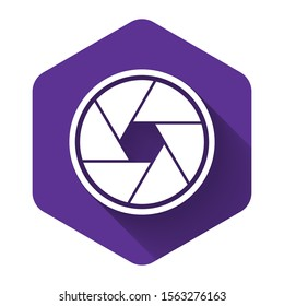White Camera shutter icon isolated with long shadow. Purple hexagon button