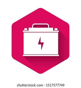 White Car battery icon isolated with long shadow. Accumulator battery energy power and electricity accumulator battery. Lightning bolt symbol. Pink hexagon button