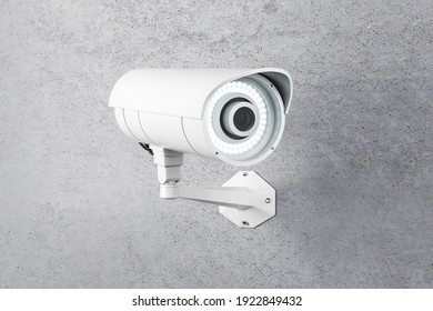 White CCTV camera installed on concrete wall outdoor. 3D rendering
