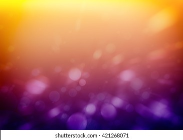 white circles or bubbles on soft purple and yellow orange background with blurred bokeh lights