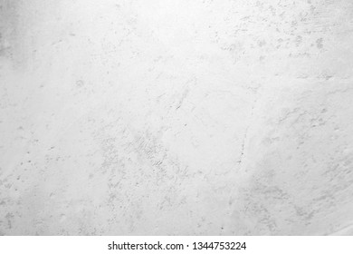 White classic texture for designer background. Illuminated surface. Space to fill. Artistic plaster. Illuminated, rough wall. Abstract pattern. Raster image.