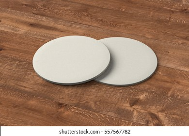 White coasters. Isolated on wooden background. Include clipping path. 3d render