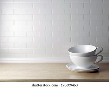 White cups on the wooden shelf in front of white wall. Kitchen design.