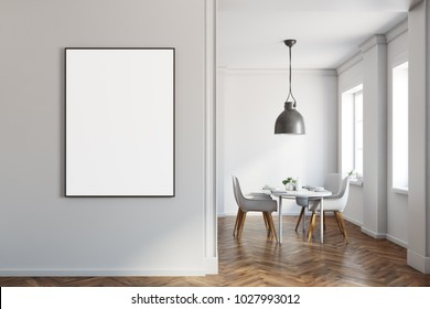 White dining room interior with a wooden floor, and a white table with chairs. A poster. 3d rendering mock up