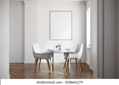 White dining room interior with a wooden floor, a white table with chairs and a framed vertical poster above it. 3d rendering mock up