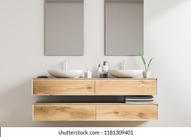 White double sink standing on a wooden vanity unit in a white wall bathroom with two vertical mirrors. Relaxation and self care concept. 3d rendering
