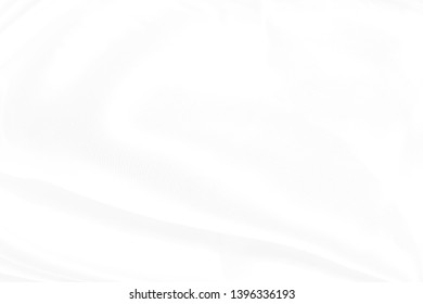 white fabric texture and cloth background abstract with soft waves.