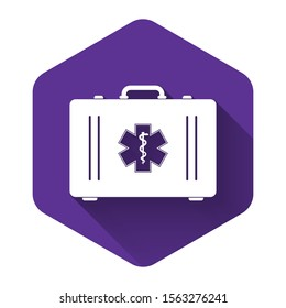 White First aid kit and Medical symbol of the Emergency - Star of Life icon isolated with long shadow. Medical box with cross. Healthcare concept. Purple hexagon button