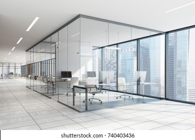 White and glass office interior with a white wooden floor, large windows with a cityscape and computer desk. 3d rendering