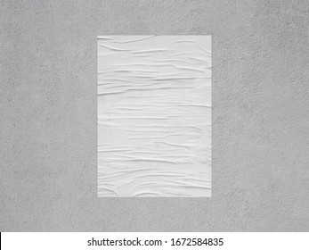 White glued adhesive poster mockup on textured wall