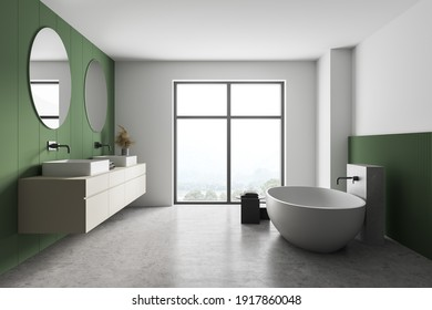 White and green bathroom with white bathtub, front view, sinks and mirrors near window. Minimalist design of modern marble bathroom 3D rendering, no people
