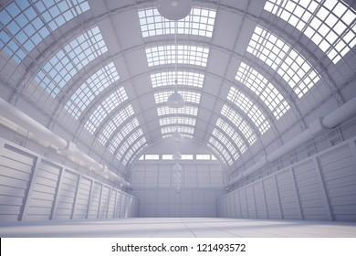 White hangar with bright sky coming trough the ceiling