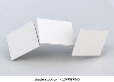 White horizontal three blank book cover flying over white background with clipping path around each book cover. 3d illustration