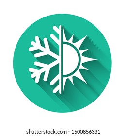 White Hot and cold symbol. Sun and snowflake icon isolated with long shadow. Winter and summer symbol. Green circle button