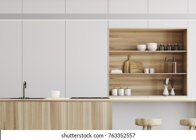 White kitchen interior with a wooden floor, a light wooden bar and white cupboards in the background. Close up 3d rendering mock up