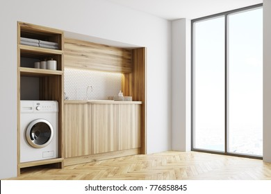 White laundry room inteior with wooden countertops and a built in washing machine. Side view 3d rendering mock up