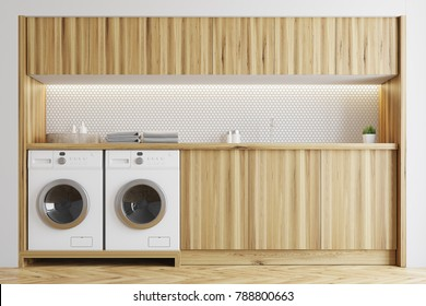 White laundry room interior with wooden countertops and built in washing machines. 3d rendering mock up