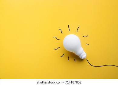 White lightbulb on yellow background Ideas creativity,inspiration,concepts.Flat lay design.