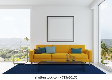 White living room interior with a yellow sofa, gray, blue and black pillows, a blue carpet, a framed square poster and loft windows. 3d rendering mock up