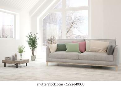 Weißes Wohnzimmer mit Sofa und Winterlandschaft im Fenster. Skandinavisches Innendesign. 3D-Illustration