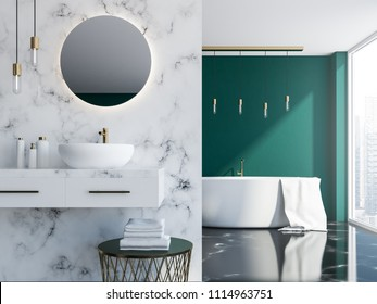 White marble and dark green loft bathroom with a sink, a round mirror and a tub near a loft window. A close up 3d rendering