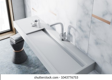 White marble wall bathroom interior with a long white sink and a chair with towels. A top view. 3d rendering