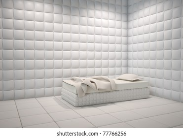 white mental hospital padded room corner with a bed